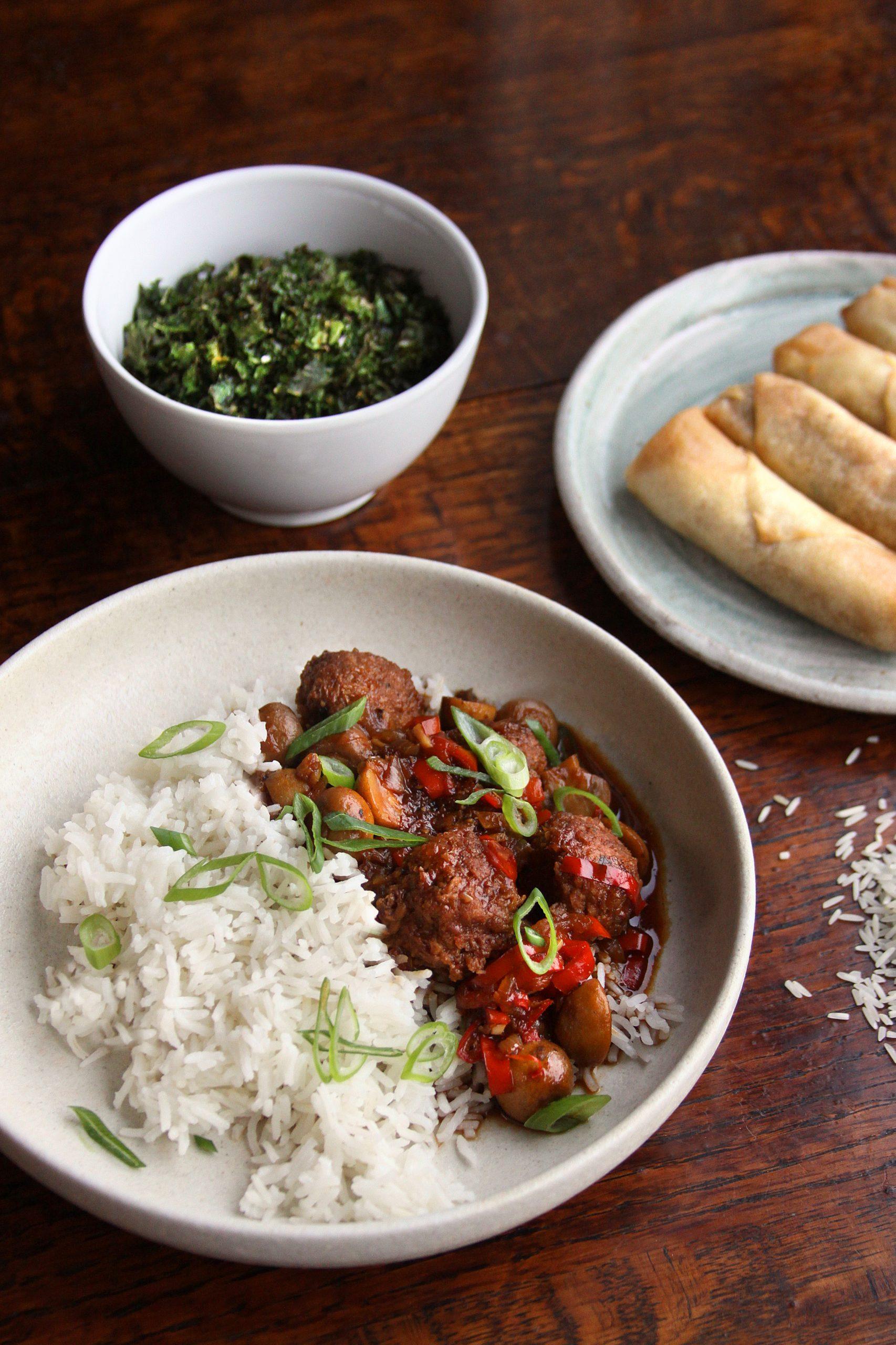 Bowl of black pepper vegan meatballs & mushrooms and rice